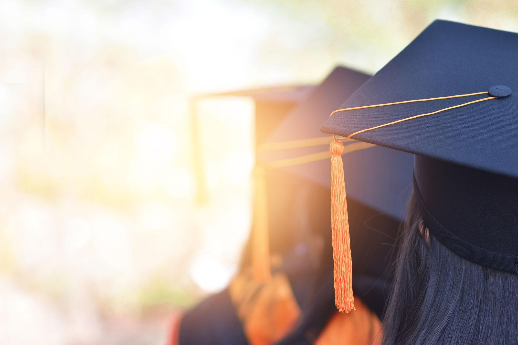 graduates with caps on