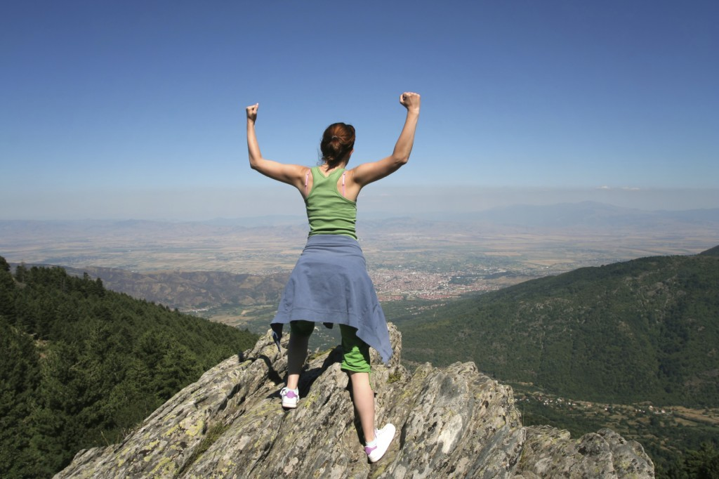woman on a mountain peak