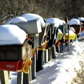 mailboxes in winter with snow on top of them