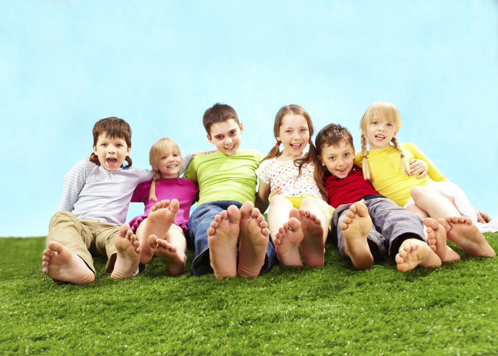 barefoot kids on grass
