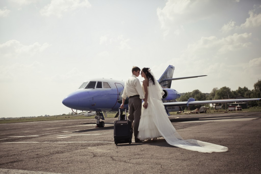 Wedding couple are prepare to fly on a honeymoon trip