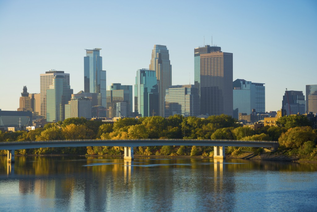 View of Downtown Minneapolis with the Mississippi River and a bridge during the early morning of an Autumn day.