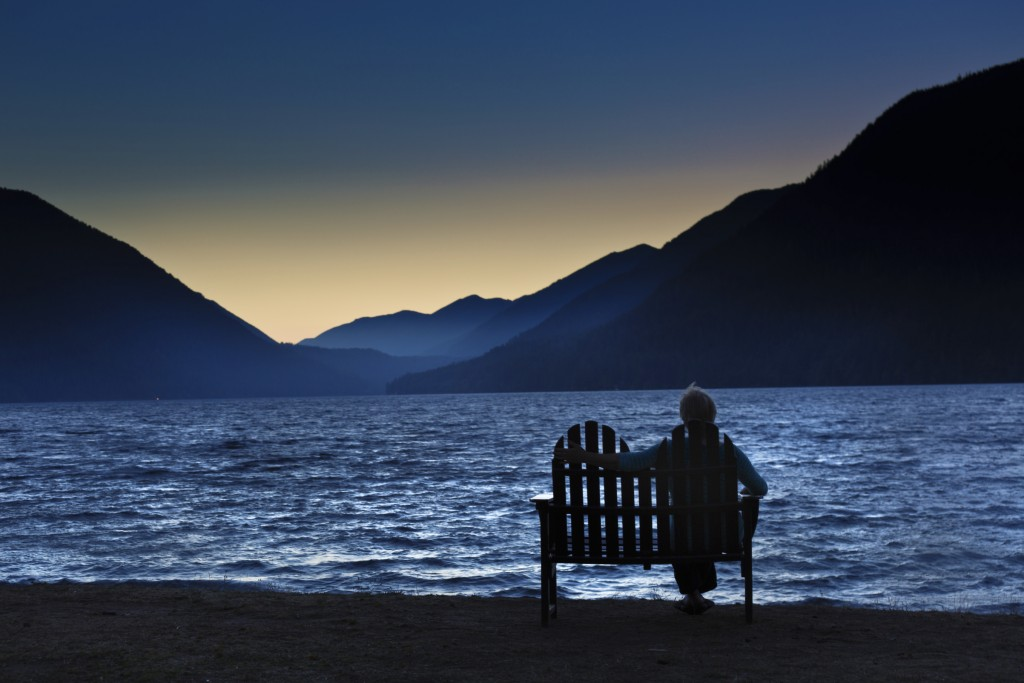 Silhouette Lonely Woman Sitting Watching the Sunrise