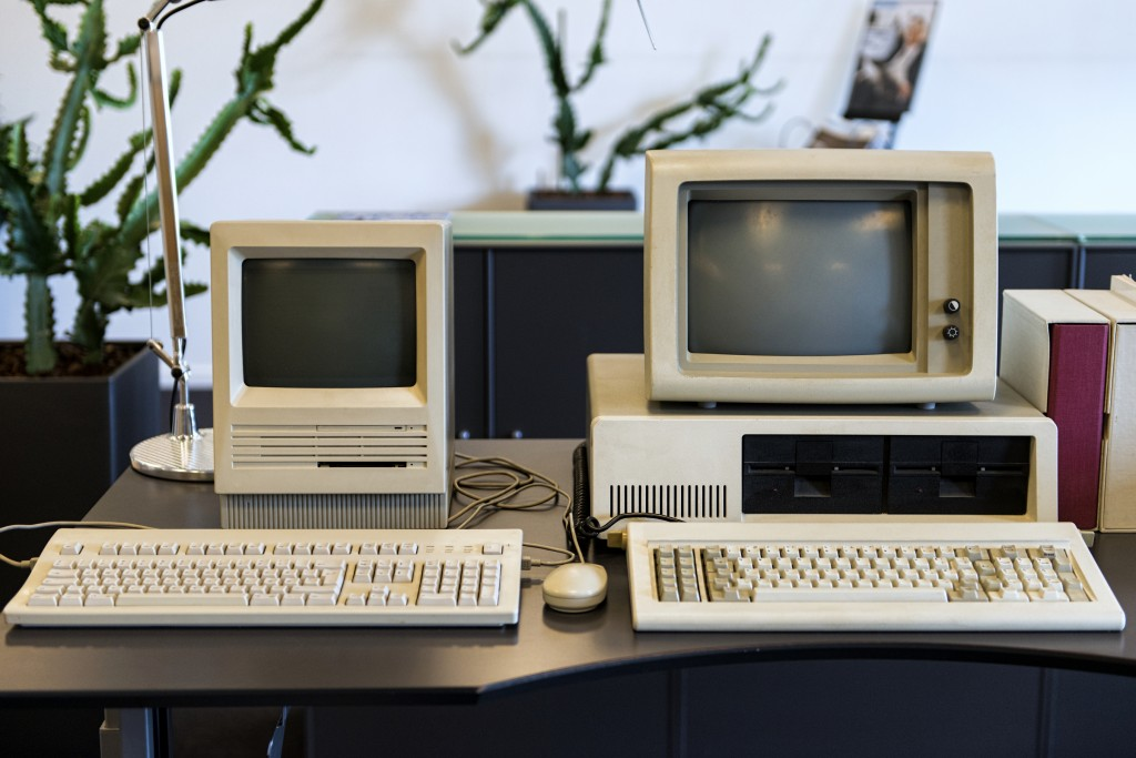 Very old computers on an office desk