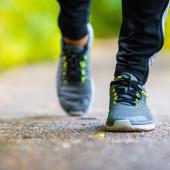 Close-up on shoe of athlete runner man feet running