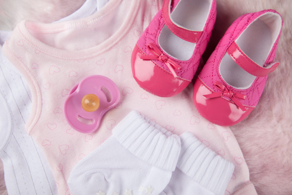 Baby Girl Outfits on soft Pink Fur background