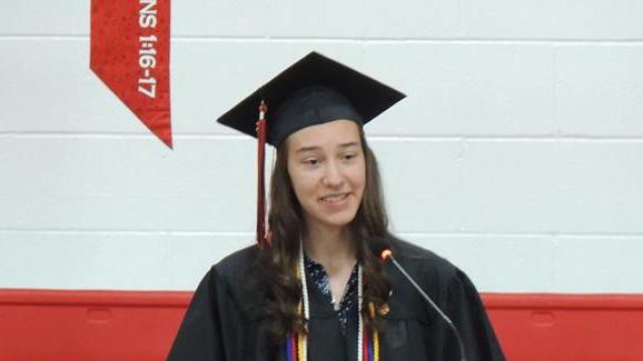 High school girl in cap & gown
