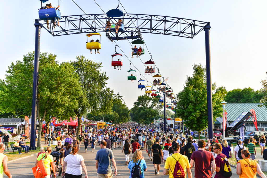 Falcon Heights, Minnesota, USA - September 3, 2017: Crowds of People and Sky Ride at the Minnesota State Fair in Falcon Heights, Minnesota. The MN State Fair is a 12 day annual event.