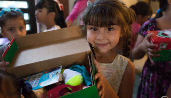 Girl holding a samaritans purse shoebox
