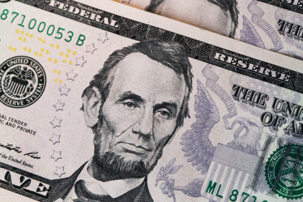portrait on a five dollar bill