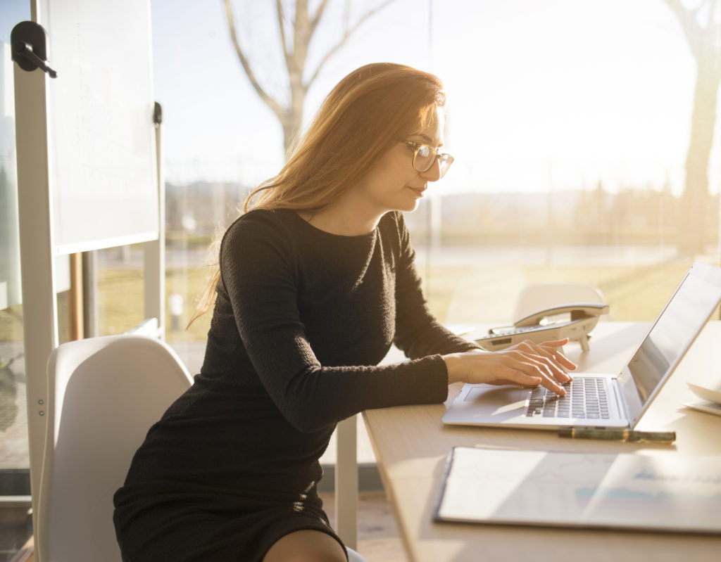 Woman working in the office with her laptop computer