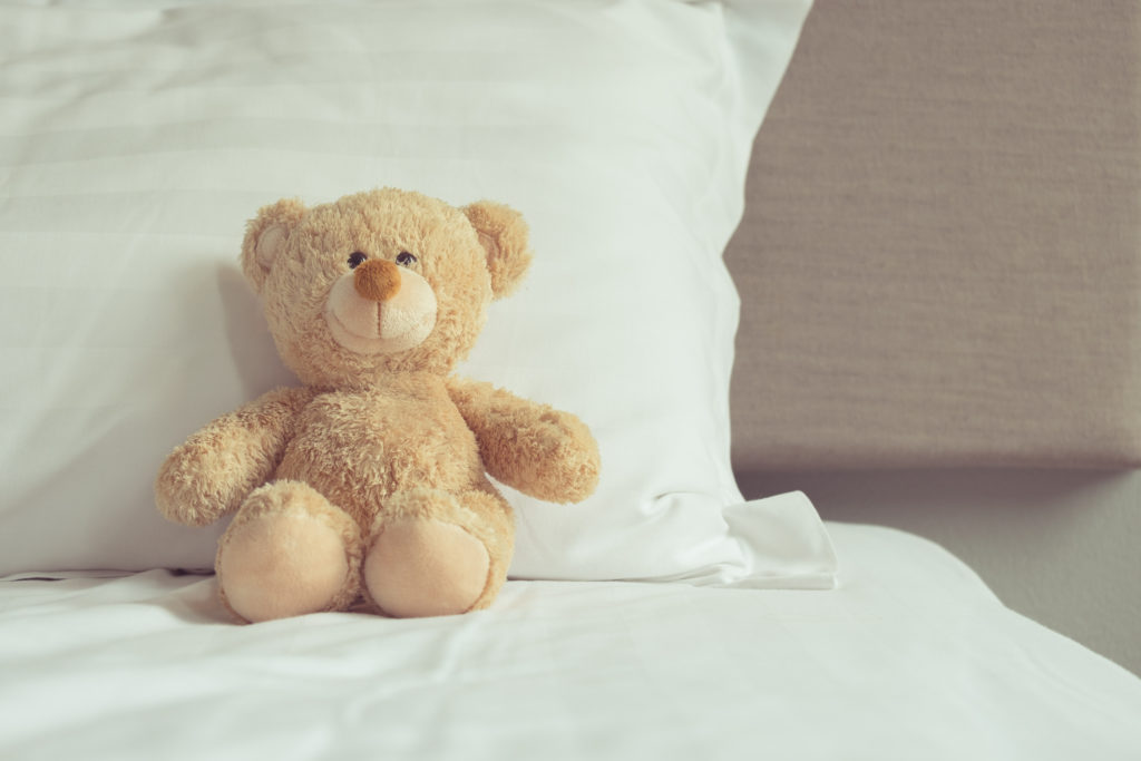 teddy bear leaning on a pillow