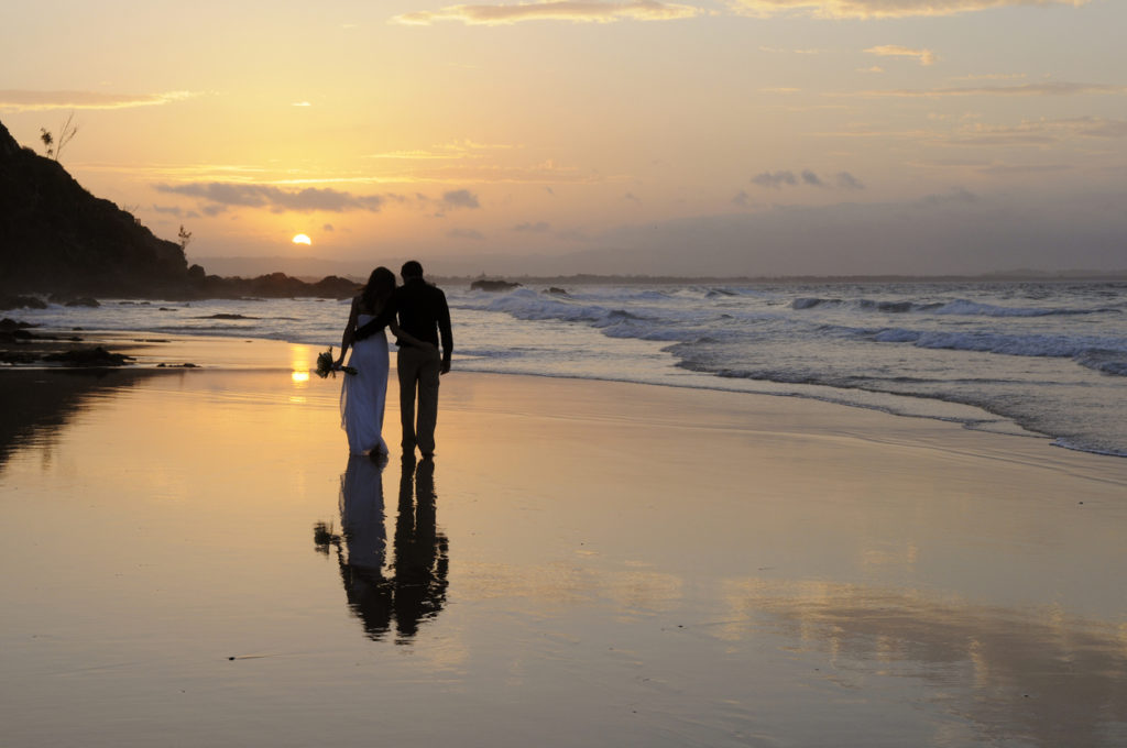 walking away together on the beach