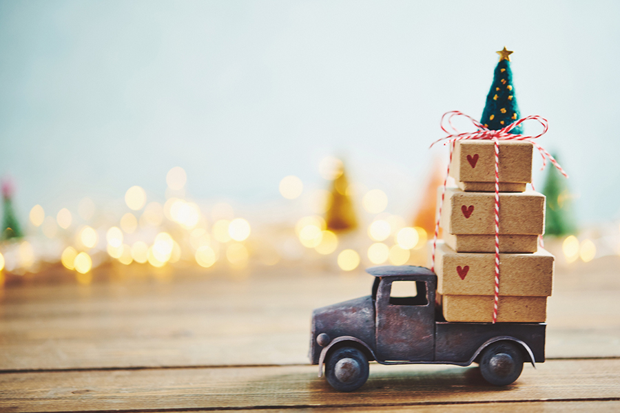 a toy truck hauling Christmas presents