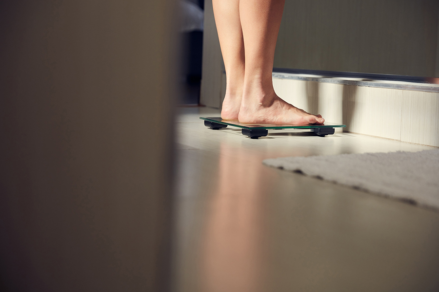 Bare feet standing on a scale