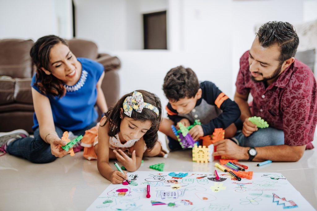 LatinoHispanic family at home, enjoying weekend with kids.