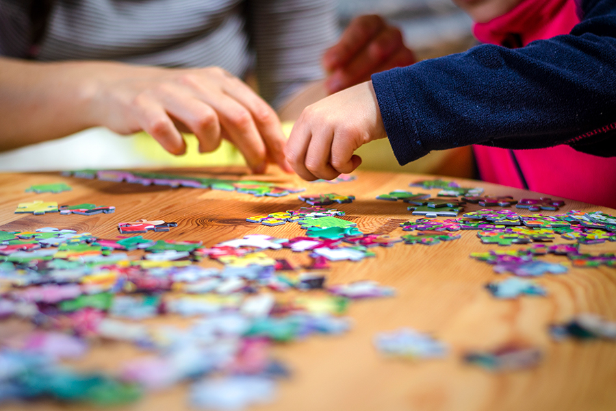 Kids putting together a puzzle