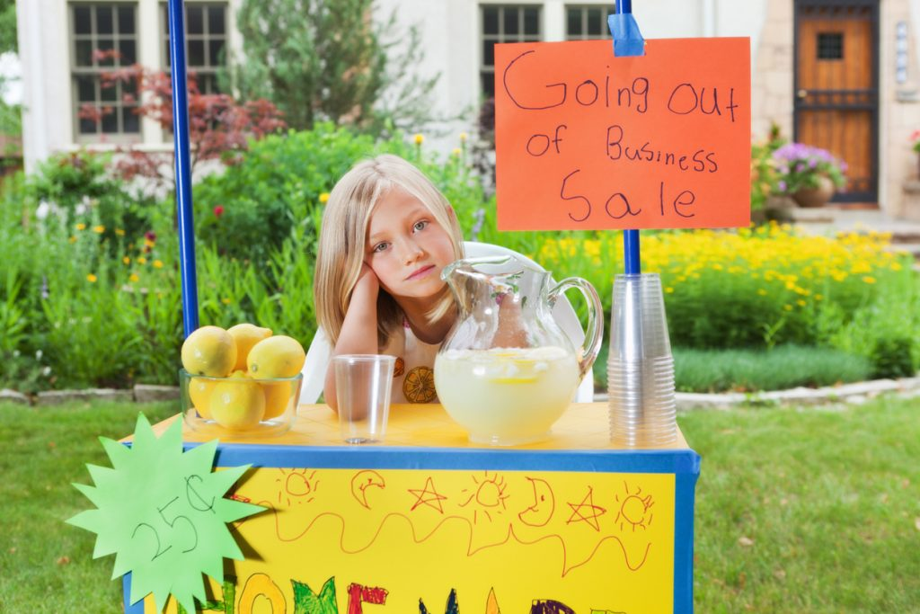 Subject: Young girl business entrepreneur owner of a lemonade stand