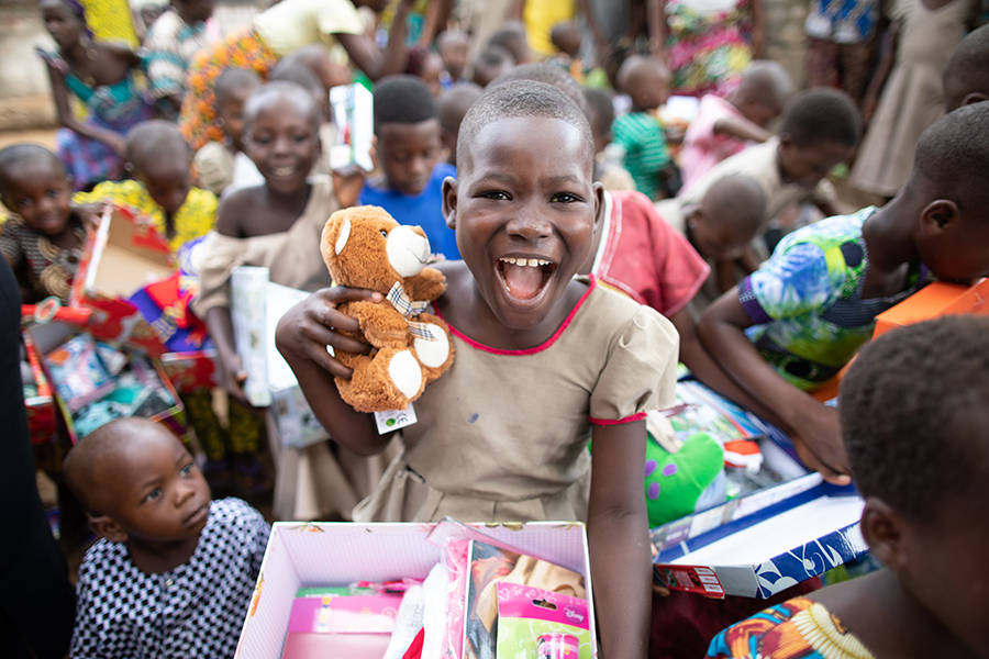 Happy girl receiving a shoebox