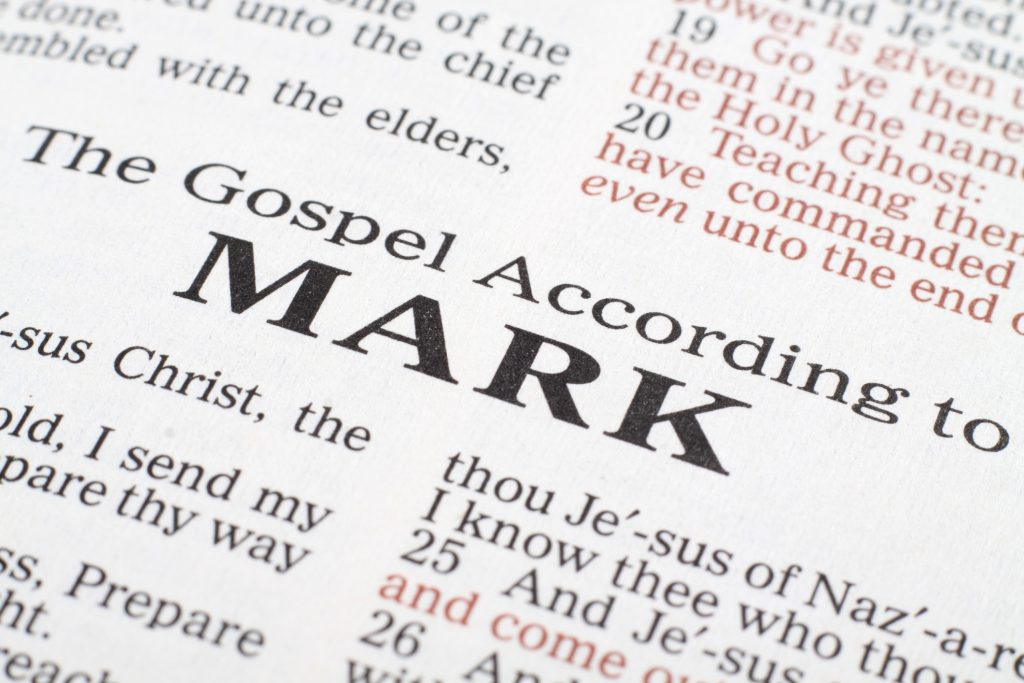 Macro focused on the title of the Gospel According to Mark