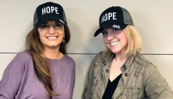 Two women wearing KTIS Hats