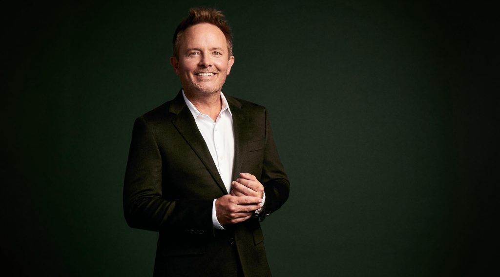 Chris Tomlin in a suit with a dark background